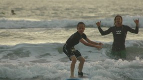 Kids taking surf lessons in Santa Teresa