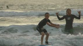 Kids taking surf lessons in Santa Teresa